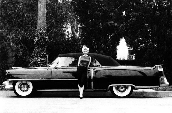 Marilyn and her 1954 black Cadillac convertible