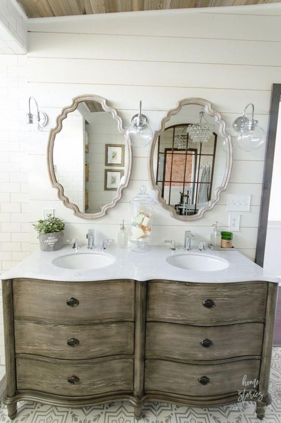 Antique style double vanity in a modern farmhouse bathroom with shiplap on walls. Come check out Antique Vintage Style Bathroom Vanity Inspiration! #bathroomdesign #bathroomvanity #classicstyle #traditionaldecor #interiordesignideas