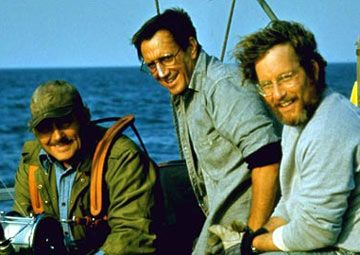 Jaws.  We always watch it around July 1st, as we live in a resort town.  We also keep hoping to see Alex Kintner's guts spill out onto the dock.