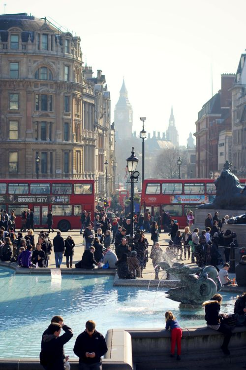 Trafalgar Square.   ** Busy as always. Great shot with the buses in the middle ground.: