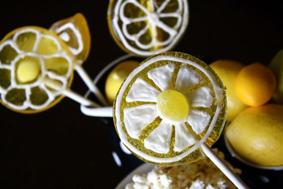 Sweet lemonade stand inspired treats! PLUS the recipe for these adorable lemon lollipops. Simple to make and less than 5 ingredients! Check it out.