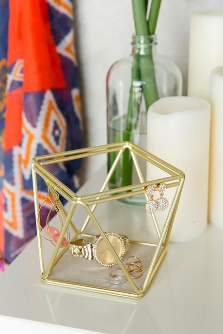 "The+Gold+Prism+Jewelry+Organizer+is+great+for+storing+earrings,+bracelets,+and+rings!+The+extra+storage+space+on+the+bottom+allows+for+items+that+do+not+hang+easily.+Pair+with+our+additional+home+decor+options+for+a+complete+look.<br+/>  <br+/>  -+6.25""+height<br+/>  -+4.5""+width<br+/>  -+4.5""+diameter<br+/>  -+By+Umbra<br+/>  -+Imported<br+/>"