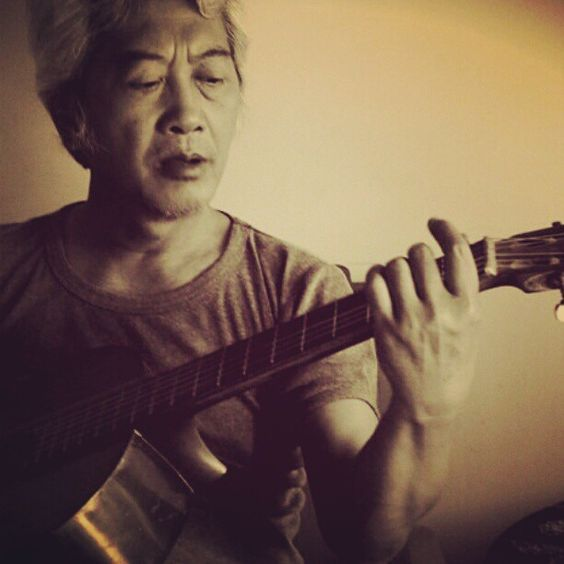 Daddy. - He loves to play guitar and I grew up listening to his vinyl collections. The pic taken last year. This one edited in Pixlr'omatic and Instagram.