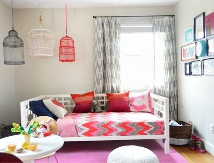 brightly painted, hanging bird cages, child's table with chairs, gallery wall
