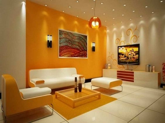 Wall color combinations orange wall white furniture http for Living room 2 color ideas