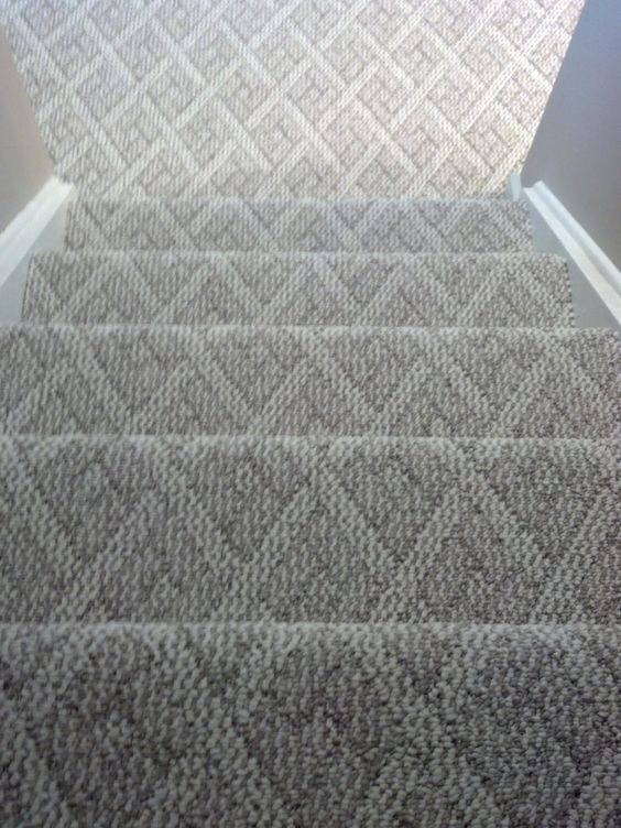 Here the carpet is a little thinner, but it has a pattern and a sort of texture to it as well. You can see it continues down from the stairs to the floor of the basement as well, for a cohesive look.