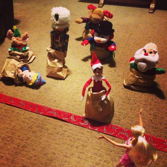 And They're Off..... Way to win Barbie's Affection.  Elf on a Shelf