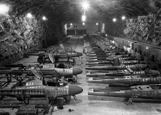 """""""Partly completed Heinkel He-162 fighter jets sit on the assembly line in the underground Junkers factory at Tarthun, Germany, in early April 1945. The huge underground galleries, in a former salt mine, were discovered by the 1st U.S. Army during their advance on Magdeburg."""" (AP)"""