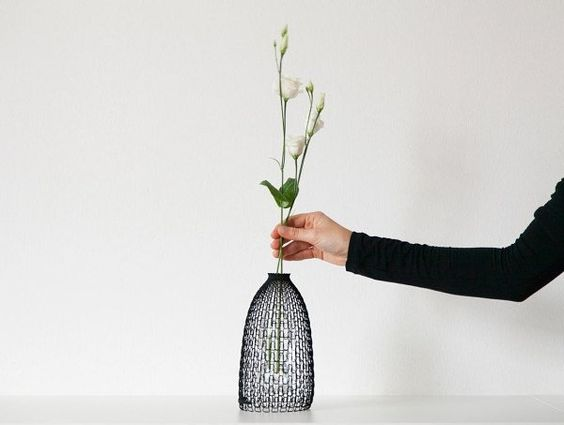Upcycling at its best Libero Rutilo's 3D printed external shell transforms any PET bottle into a slick vase. by nirvanacph
