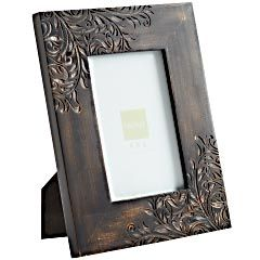 Such a cute accent! Etched Wood Frame by Pier 1 for $14.95.