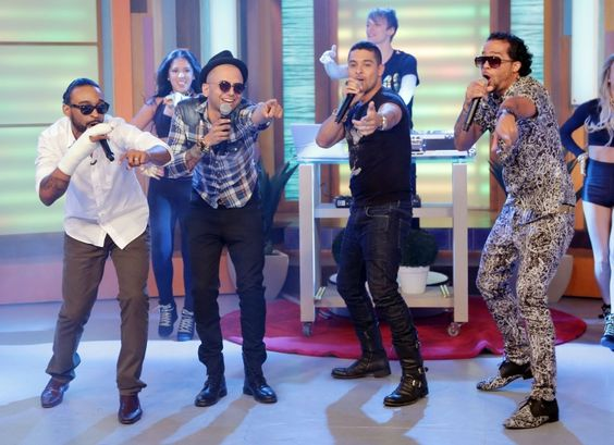 "Rappers Reek Rude and Sensato, actor Wilmer Valderrama and LMFAO's Sky Blu party rock during a performance of ""Salud"" on ""Despierta America"" on Oct. 24 in Miami"