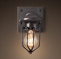 Metropolitan Railway Sconce - RH's Metropolitan Railway Sconce:Modeled after the classic New York City subway lights of 1910, this steadfast sconce is constructed of enduring aluminum and steel. Its caged enclosure houses a standard bulb or an antique-style filament that mimics the glow of a warmly lit station.