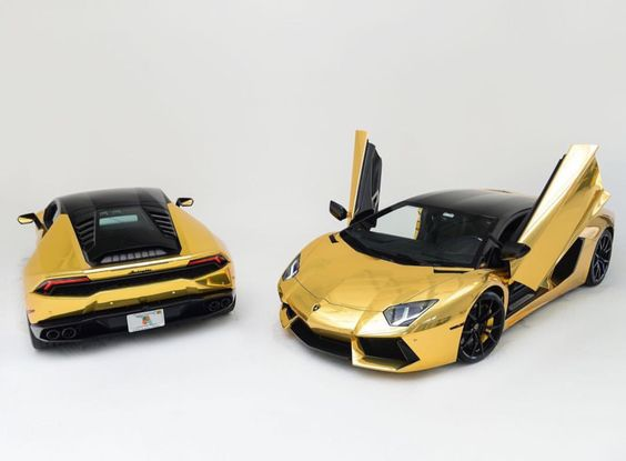 Lamborghini Aventador Coupe and Huracan both wrapped in Chrome gold w/ Satin Black roofs   Photo taken by: @elitelifestyles on Instagram