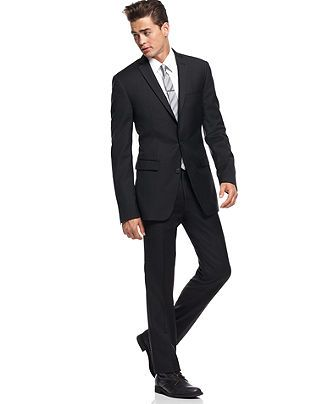 Slim cut dark suit is okay for interviewing; fit is key