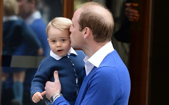 The Duke of Cambridge gives Prince George a kiss as they arrive at the Lindo Wing