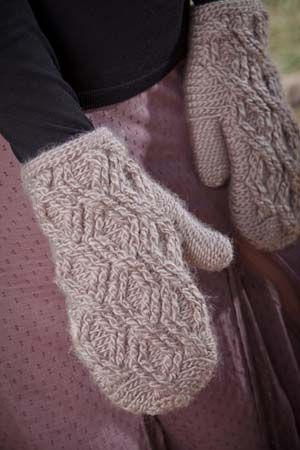 """Go There Now Cables interlock against a slip-stitch background on these überwarm, deliciously comfortable mittens. Designer: Brenda K. B. AndersonFinished Size: 7½ (8½, 9¼)"""" palm circumference above thumb and 9″ (9¾, 10½)"""" long, to fit woman's small/medium (woman's medium/large, man's small/medium). Mittens shown measure 8½"""" in circumference.Yarn: Caron Sheep(ish), (70% acrylic, 30% wool; 167 yd…"""