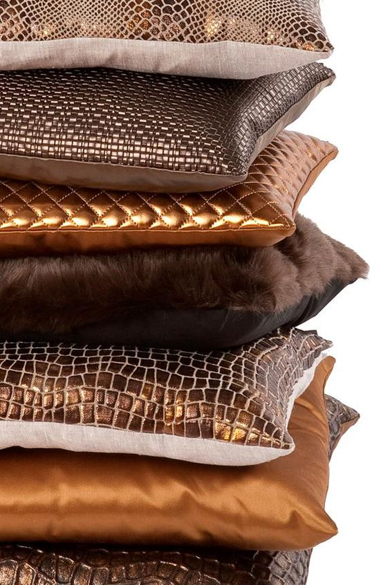 Metallic Brown and bronze pillows stacked