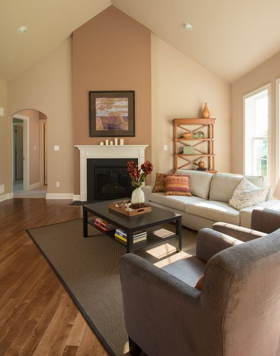 Great room with a cathedral ceiling, hardwood flooring ...