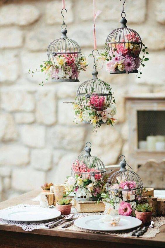 beautiful unique decoration idea, hanging flowers, birdcages, romantic table set up, wedding event