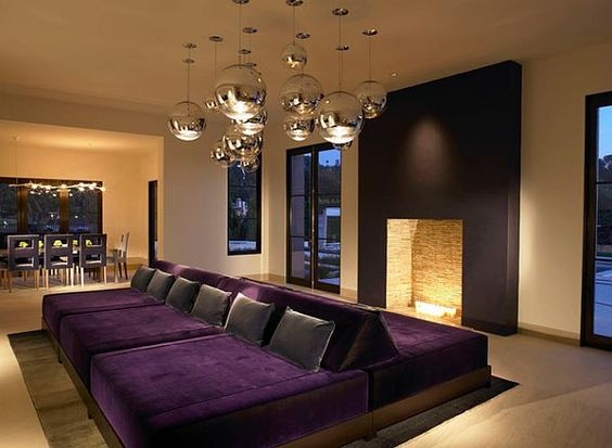 Gorgeous Purple cushions go great with a vivacious home theater setting