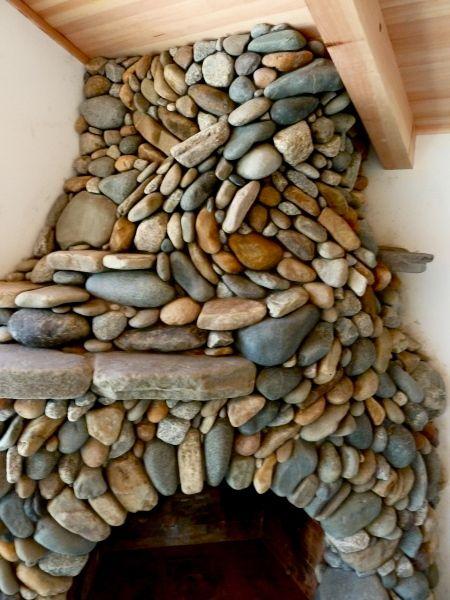 amazing, beautiful river stone fireplace!