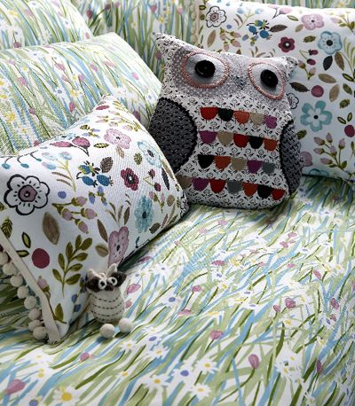 uk company prestigious textiles. the first collection is called jamboree and features painterly roses and petals amongst more folky motifs and florals.
