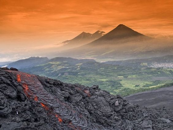 Volcanoes from Guatemala: Fuego, Agua, and Acatenango (front). The lava is from Volcano Pacaya: