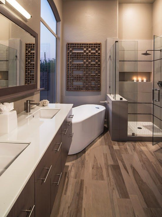 Photo Gallery In Website contemporary bathroom with glass shower freestanding tub double sink hardwood floor picture window and one of a kind wall art l designed by Friedman and