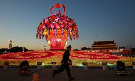 Illuminated giant flower pot on Tiananmen Square, Beijing. Photograph: Feng Li/Getty Images