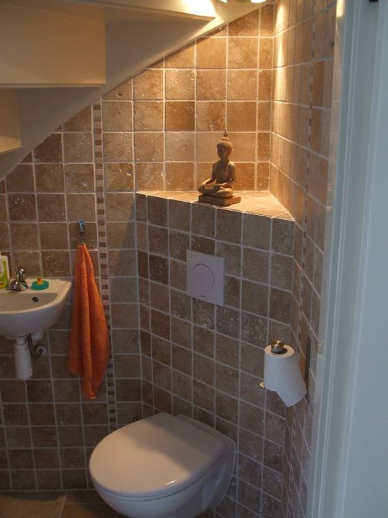 Toilets read more and stairs on pinterest for Bathroom under staircase designs