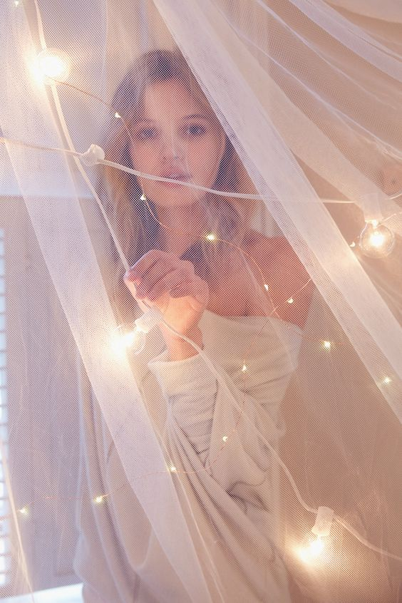 ADD a Mosquito Net over the Bed or near a Window + surround with Twinkling Lights!: