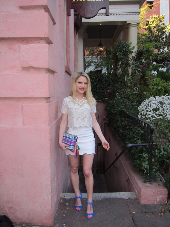 Caitlin Hartley of Styled American lace crop top, scalloped skirt, colorful wristlet and blue pumps http://styledamerican.com/the-olde-pink-house/