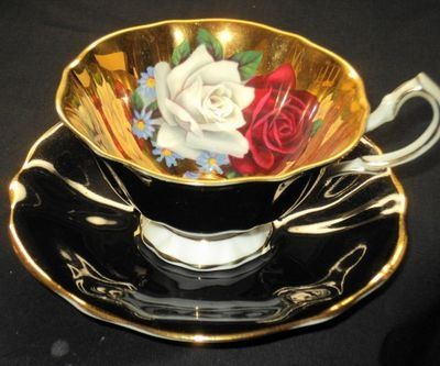 Queen Anne, England. Gold Roses Black Wide TEA CUP AND Saucer                                                                                                                                                                                 More