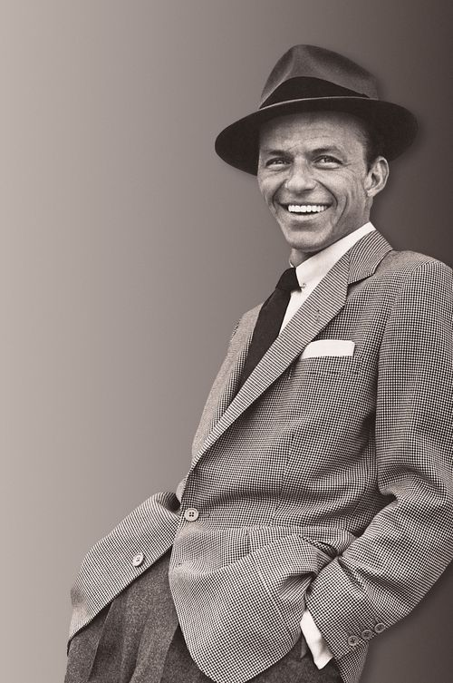 Frank Sinatra...It was in the 80's at OU's Lloyd Noble Center.  He was 72 years old, silver hair, blue eyes, tuxedo and holding a glass of red wine.  I was about 20.  And I still would have gone home with him.  He was indescribable!