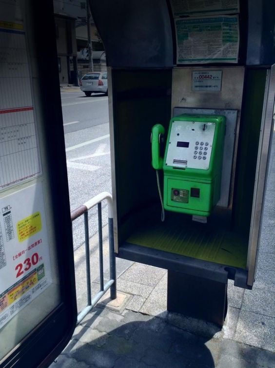 A public telephone. Shijo-dori Street is one of the major east-west streets in Kyoto City.