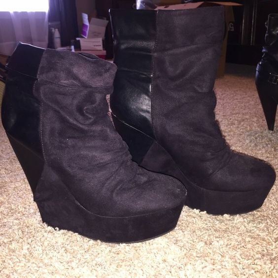 Suede platform wedge booties Black wedge booties with fabric that can be folded or left straight up. I have one bootie with the ankle cuffed and the other is straight up. These are black suede in the front and the heel is black leather. Size 9 women's. Charlotte Russe Shoes Ankle Boots & Booties