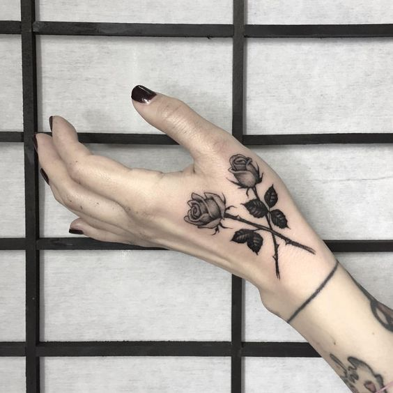 Roses On Hand Tattoos Small Rose Tattoo Rose Hand Tattoo Tattoos