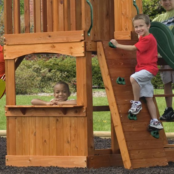 Learn more about the Atlantis wooden playset. This Backyard Discovery swingset has a slide, sandbox, rockwall and more!