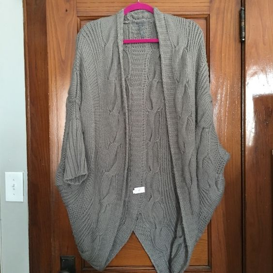 Gray shrug like sweater. Wore this once with boots and leggings. Sweater has a worn, relaxed look. Cozy and comfy. Bought it like that. I wore it with messy hair, leggings, and boots on a camping trip. Super comfy. Sweaters