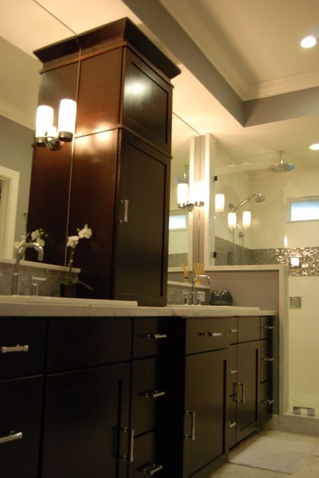 center stack vanity next to glassed in shower master