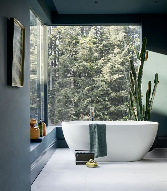 Stunning bathroom with an amazing view of the woods. This is what I call a luxury bathroom. I could spend hours here.: