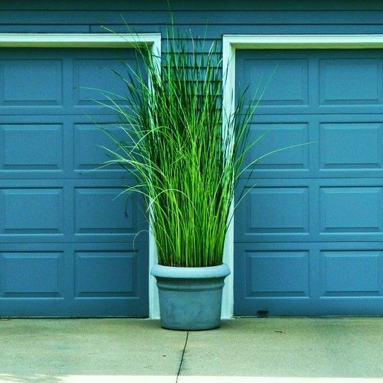 Garage Door Landscaping Ideas: Tall Grass In Planters On Either Side Of Garage Door