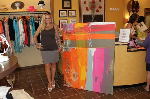 Austin artist Karen Salem standing next to one of her custom art pieces - we love the colors!