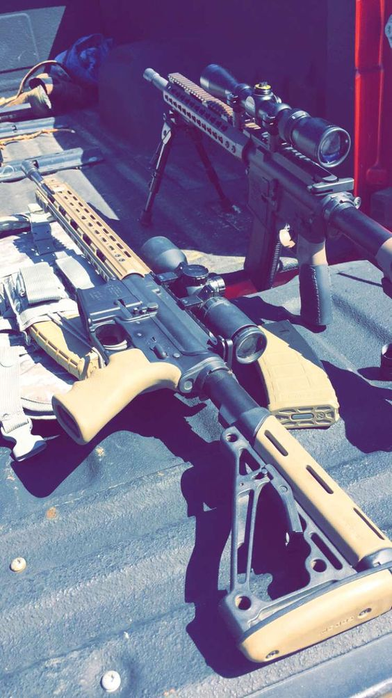 Mine and a buddy's AR 15 builds out at the range.