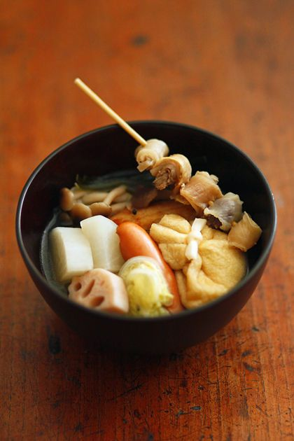 Oden - Oden is a Japanese winter dish consisting of several ingredients such as boiled eggs, daikon radish, konnyaku, and processed fish cakes stewed in a light, soy- flavoured dashi broth.