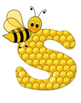Alfabeto de abeja sobre letras de panal.:
