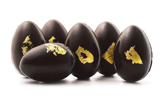 I know these are actually chocolate, but they got me thinking about painting wooden or paper maché eggs and then applying small bits of gold leaf.