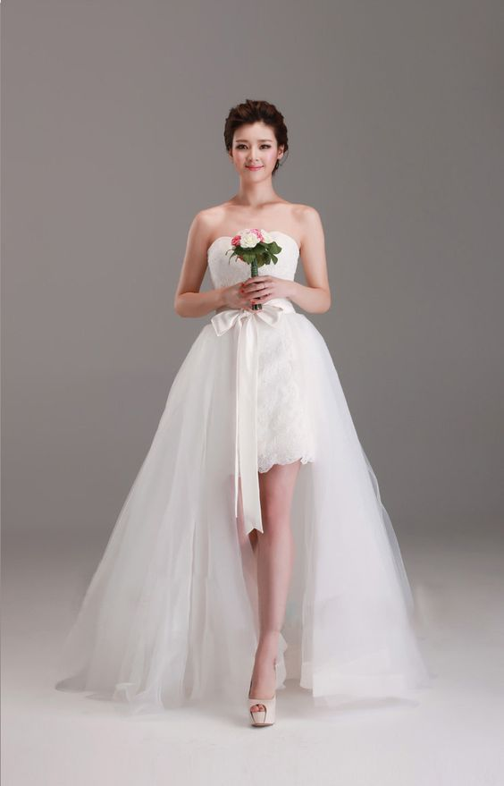 With 2 wearing sleeveless short lace wedding dress with for Removable tulle skirt wedding dress