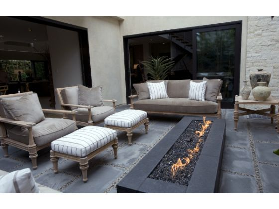 A fire pit is the focal point of a porch at this Snug Harbor Road house on the tour in Newport Beach.