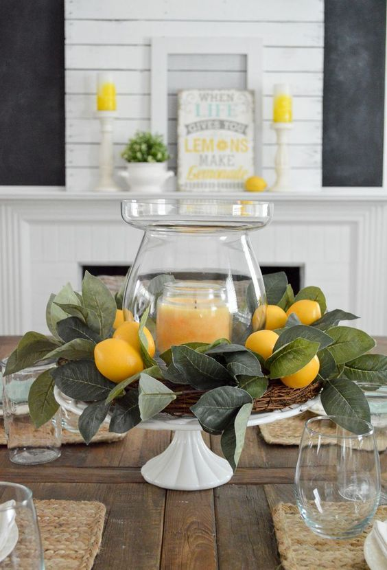 Simple Summer Decorating Home Tour | Decorating idea: need a centerpiece, fast? Use a cake plate, like this vintage milk glass pedestal I picked up out thrifting! Just layer it with a vase and candle. Encircle with a wreath, and you're done!